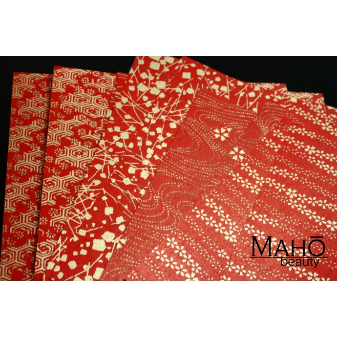 Traditional Japanese Yuzen washi origami folding paper with golden patterns