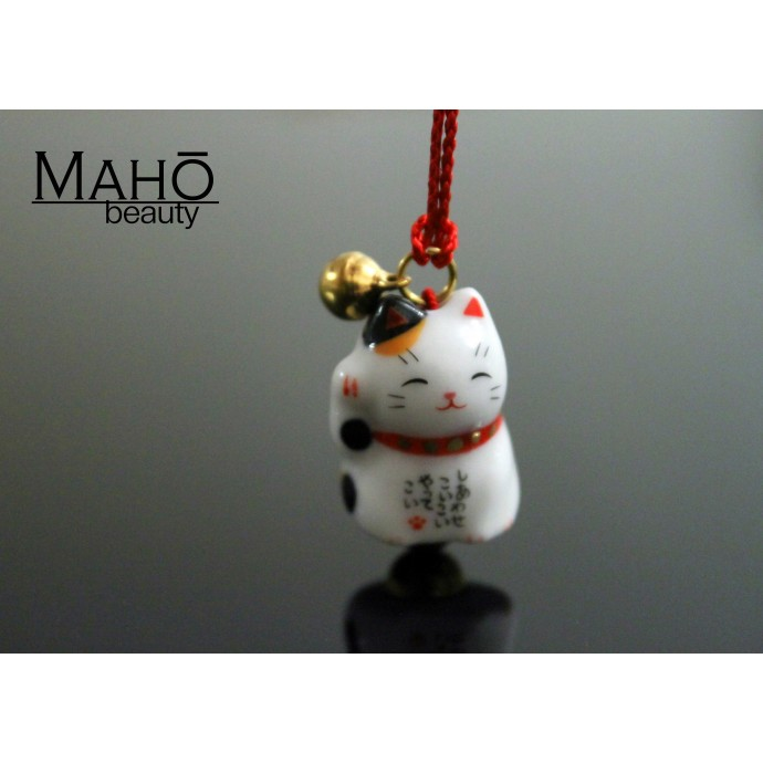 Cute good luck charm Maneki Neko - Japanese fortune cat. tri-color